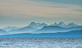 View of the Coast Mountains of continental British Columbia (the Canadian portion of the Cascade Mountains/Pacific Cordillera) across the Georgia Strait from Vancouver Island, north of Nanaimo. Canada
