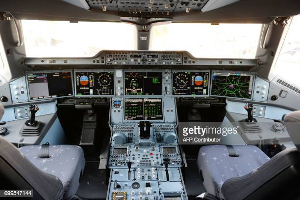 View of the cockpit of the Airbus A3501000 parked on the tarmac in front of the Airbus pavilion at Le Bourget on June 22 2017 during the...