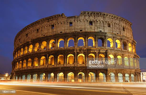 A view of the Coliseum in Italy with blurred traffic