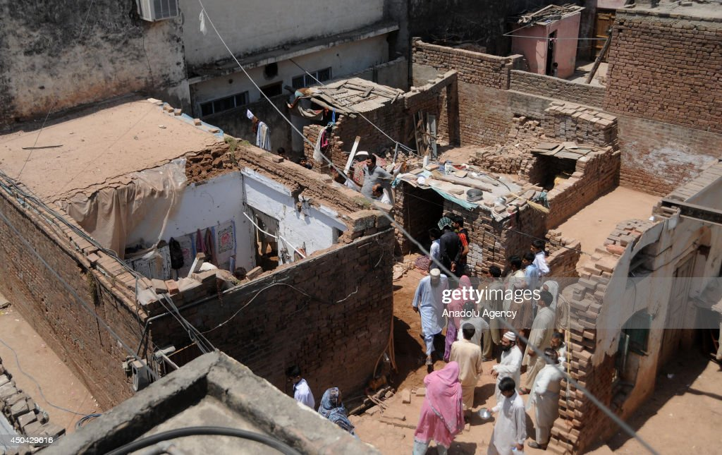 A view of the collapsed house in Rawalpindi, Pakistan on June 11, 2014. At least five children were killed while three others were retrieved from the debris of their collapsed house by the rescuers. The injured were shifted to hospital for medical treatment.