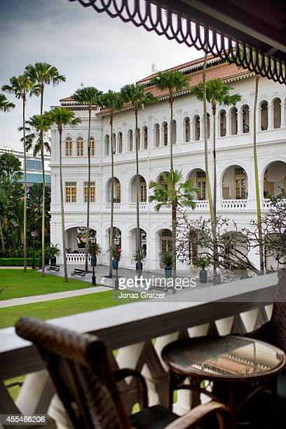A view of the colonial style Raffles Hotel building from one of the balconies of a hotel room