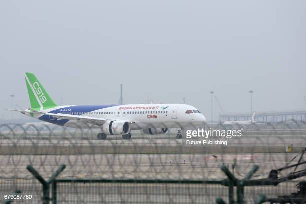 A view of the Comac C919 airplane during its first test flight at the Pudong International Airport on May 05 2017 in Shanghai China Feature China /...