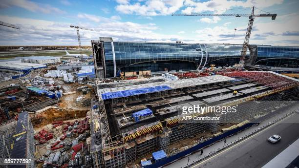 A view of the construction site of a new part of the Domodedovo airport's terminal outside Moscow on October 10 2017 The new part of Domodedovo...