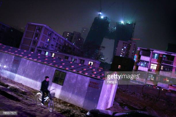 A view of the construction site of the China Central Television Headquarters where the two leaning towers are being joined at the Central Business...