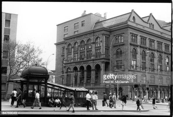 View of the Cooper Union for the Advancement of Science and Art private university and the Astor Place subway station kiosk New York New York mid to...