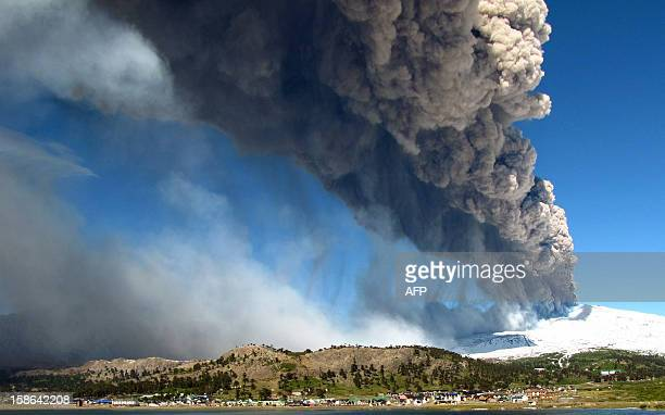 View of the Copahue volcano spewing ashes from Caviahue Neuquen province Argentina some 1500 km southwest of Buenos Aires on December 22 2012 The...