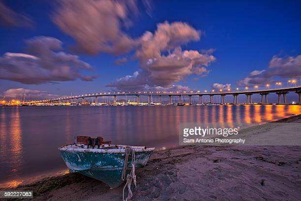 View of the Coronado Bay Bridge and shoreline boat