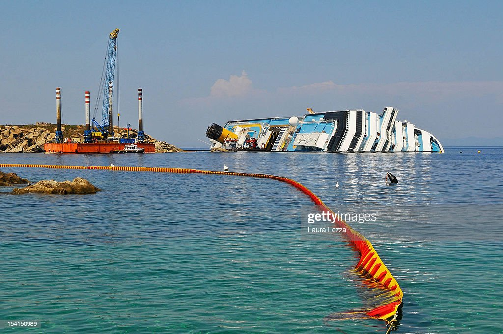 A view of the Costa Concordia that has become the subject of the investigations of the Codacons experts is seen on July 25, 2012 in Giglio Porto, Italy. The Codacons is a group of university professors and experts engaged in the work of data analysis of the black box and procedural documents relating to the investigation of the sinking of the Costa Concordia cruise liner. A preliminary court hearing into the incident starts on October 15, 2012 in Grosseto, Italy, during which experts will present their findings.
