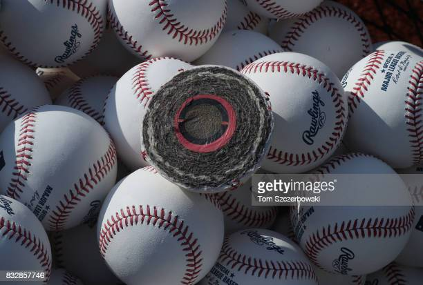 A view of the crosssection and inside of an offical major league baseball which has been cut in half showing the tightly wound string and yarn and...