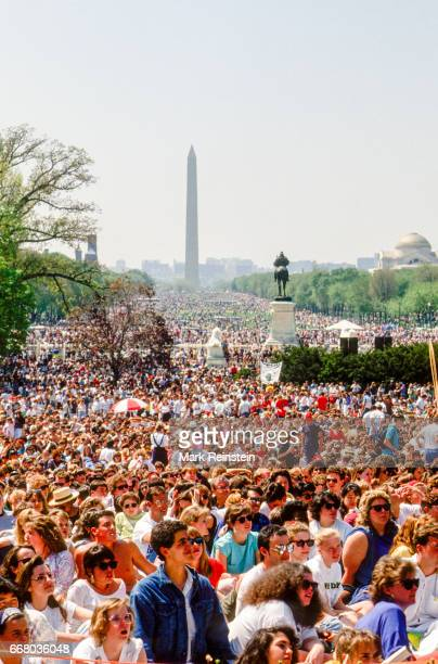 View of the crowd gathered of the US Capitol grounds for an Earth Day rally Washington DC April 22 1990 Visible in the background is the Washington...