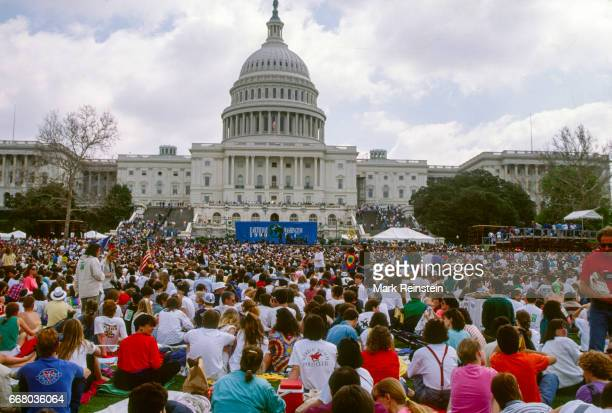 View of the crowd gathered of the US Capitol grounds for an Earth Day rally Washington DC April 22 1990 Visible in the background is the US Capitol...