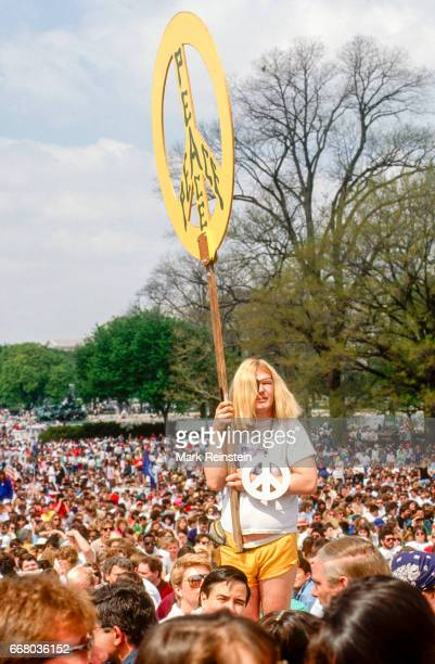 View of the crowd gathered of the US Capitol grounds for an Earth Day rally Washington DC April 22 1990 One demonstrator with an eyepatch and a 'Gay...