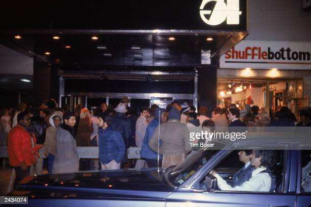 View of the crowd of people waiting to gain entry to the nightclub Studio 54 New York City 1980