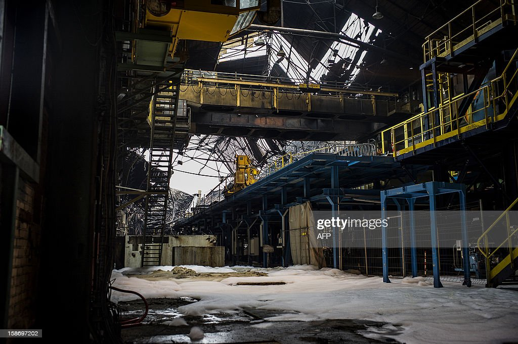 A view of the damage at Aperam stainless steel factory, controlled by the Mittal family, on December 24, 2012 in Gueugnon, central France, after a fire broke out overnight, burning 4000 square meters with no casualties.
