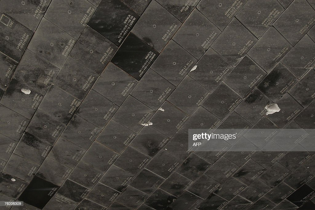 View of the damaged tiles on the underbelly of the space ...