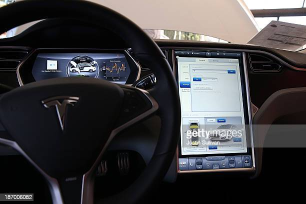 A view of the dashboard in a new Tesla Model S car at a Tesla showroom on November 5 2013 in Palo Alto California Tesla will report third quarter...