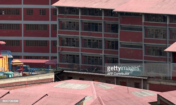 A view of the Delhi Public School during a gunfignt with suspected militants and Indian government forces at Panthachowk on the outskirts of Srinagar...