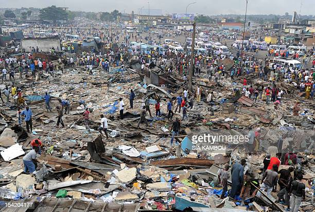 View of the destroyed market a day after clashes in the neighborhood of Abobo in Abidjan on October 16 2012 Ivory Coast police yesterday fired tear...