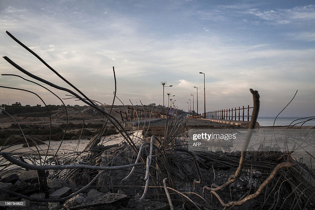 A view of the destroyed Wadi Gaza bridge, a strategic link between the northern and southern areas of the Gaza Strip, following an overnight Israeli air strike on November 21, 2012. Today's bloodshed raised to 148 the total number of Palestinians killed in a week of relentless Israeli air strikes which began at 1400 GMT on November 14, the health ministry said, indicating that more than 1,100 people have also been injured. AFP PHOTO/ANNIBALE GRECO