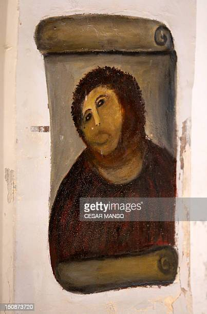 View of the deteriorated version of 'Ecce Homo' by 19thcentury painter Elias Garcia Martinez at the Borja Church in Zaragoza on August 28 2012 An...
