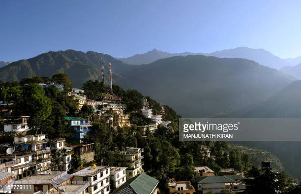 A view of the Dharamshala town is seen amidst the Dhauladhar range of mountains from the Namgyal Monastry on September 26 2012 About 400 Tibetans...