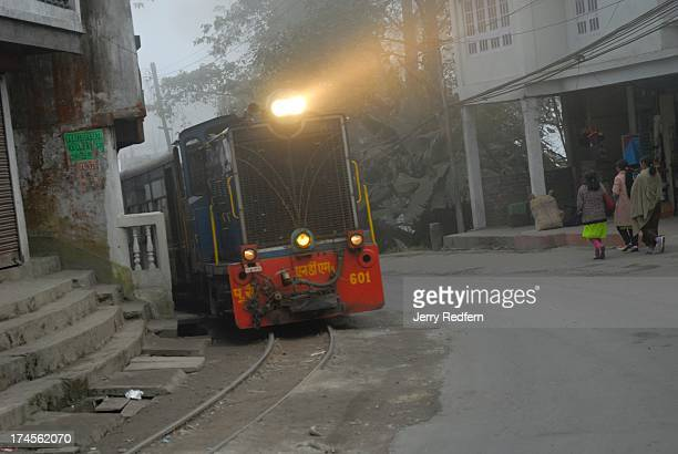 View of the diesel engine that pulls the Toy Train between Siliguri and Darjeeling as it passes through the town of Kurseong The Darjeeling Himalayan...