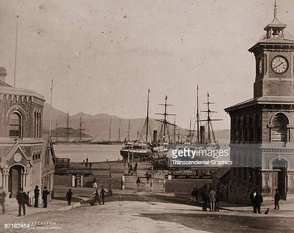 View of the dock and nearby streets and buildings in Lyttelton New Zealand 1868