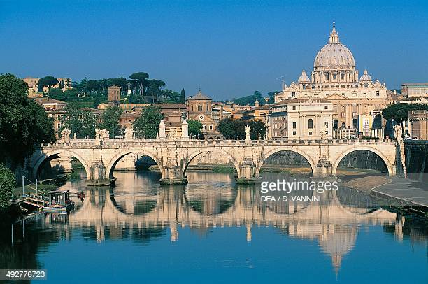 View of the dome of St Peter's Basilica 16th17th century and Sant'Angelo bridge 2nd century over the Tiber river Vatican City Italy