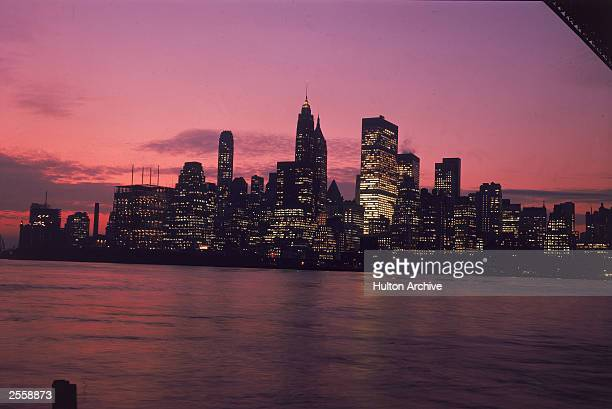 A view of the downtown Manhattan skyline at dusk from Brooklyn circa 1970