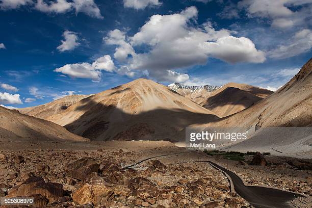 A view of the dry arid mountains landscape from Tangtse monastery and the road leading to idyllic Pangong lake