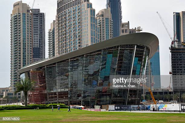 A view of the Dubai Opera house which is currently under construction from Burj Park in Downtown Dubai on April 08 2016 in Dubai United Arab Emirates