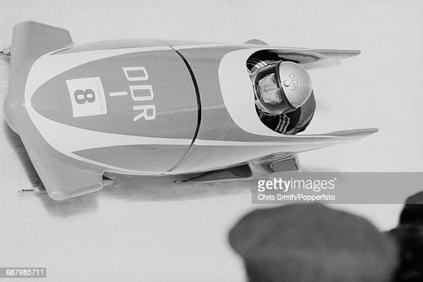 View of the East Germany 1 twoman bobsleigh team of Wolfgang Hoppe and Bogdan Musiol in action during competition to finish in second place to win...