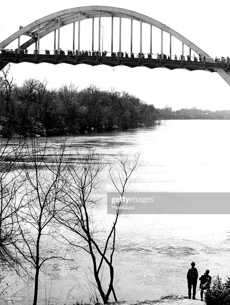 View of the Edmund Pettus Bridge across the Alabama river as it is crossed by thousands of Civil Rights demonstrators during the third Selma to Montgomery march for voting rights, Selma, Alabama, March 21, 1965. The first and second marches, earlier in the month had been stopped, the first violently, by police and state troopers; the third march was completed, under the protection of federally ordered National Guardsmen.