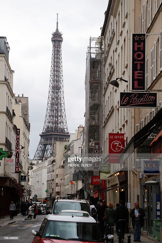 A view of the Eiffel tower rising above buildings in Paris, on May 10, 2013.
