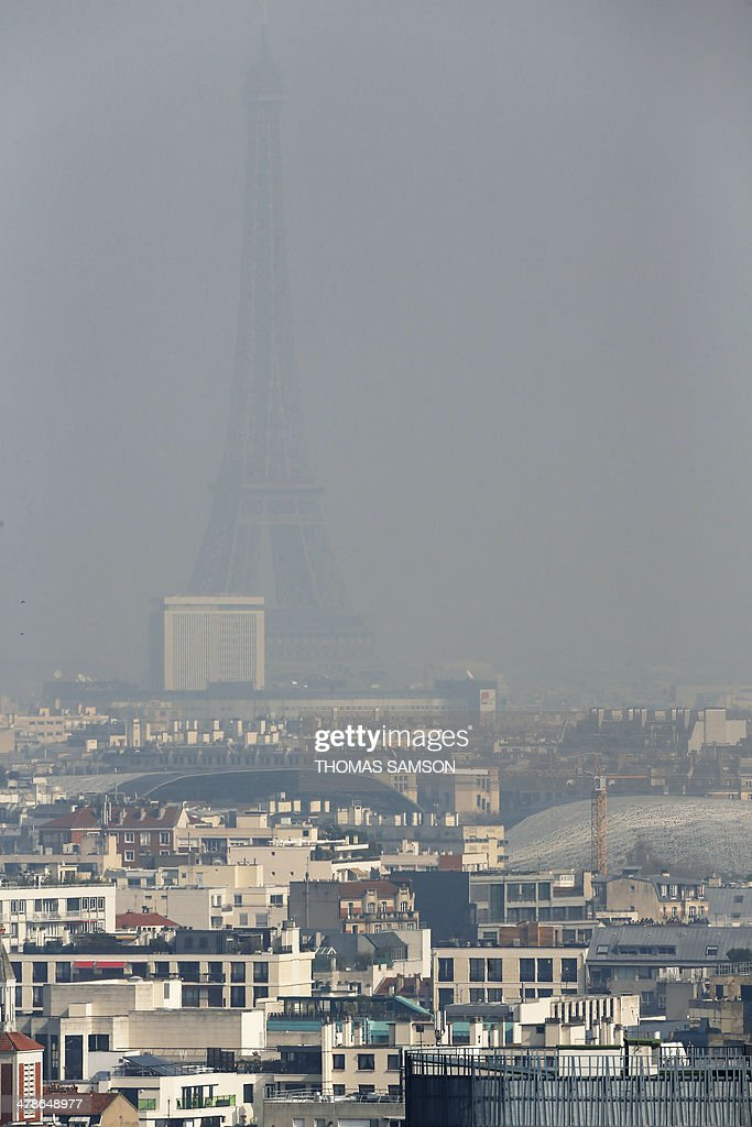 A view of the Eiffel Tower seen through thick smog, on March 14, 2014, in Paris. Fine particle pollution in several French cities continued unabated today as the modest measures taken by local authorities failed to solve the underlying problem.