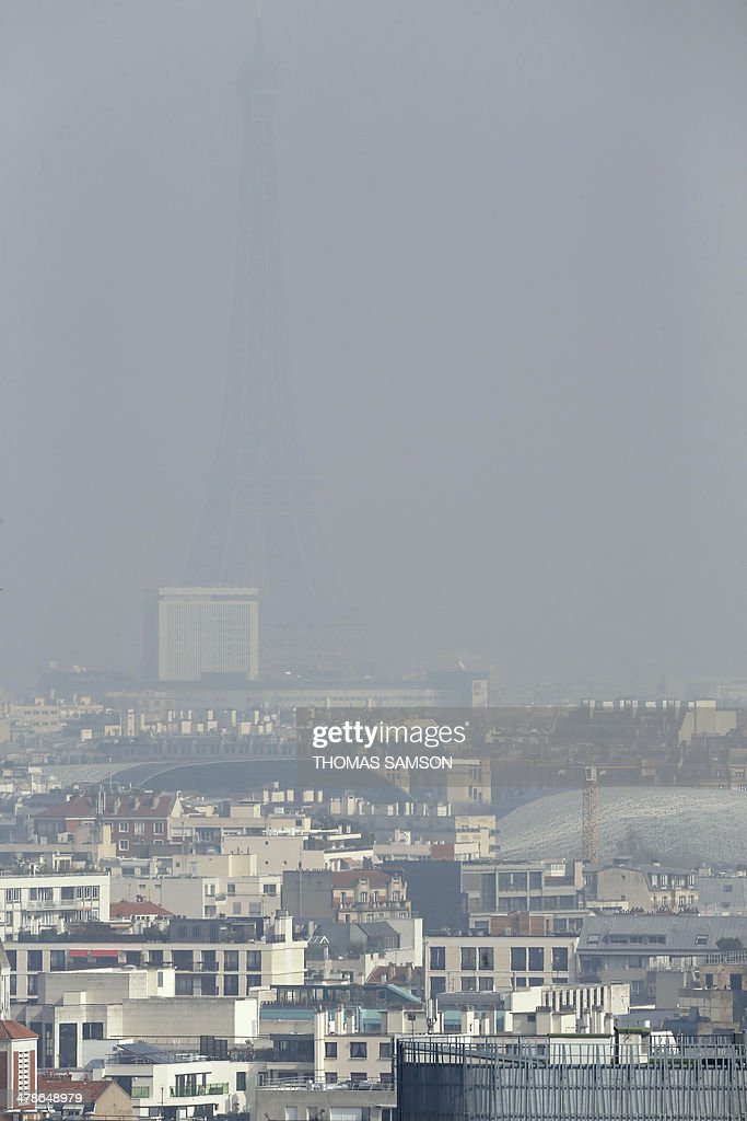 A view of the Eiffel Tower seen through thick smog, on March 14, 2014, in Paris. Fine particle pollution in several French cities continued unabated today as the modest measures taken by local authorities failed to solve the underlying problem. AFP PHOTO / THOMAS SAMSON