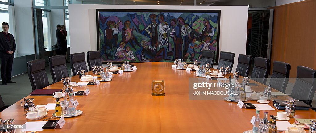 View of the empty conference table prior to a meeting of the German cabinet at the chancellery in Berlin on October 16, 2013. Merkel's Christian Democratic Union (CDU) is still locked into coalition talks with the Social Democratic Party (SPD) over forming the next federal government after general elections which denied an overall majority in parliament for the CDU.