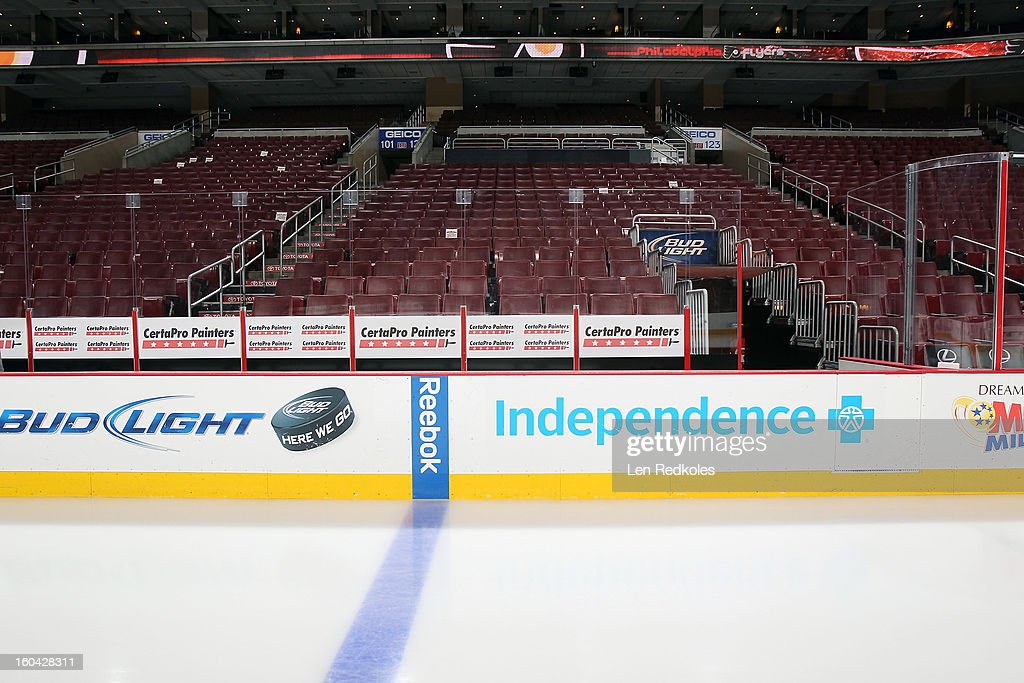 A view of the empty Flyers bench, dasher boards, arena and ice surface prior to a NHL game between the Philadelphia Flyers and the New York Rangers on January 24, 2013 at the Wells Fargo Center in Philadelphia, Pennsylvania.