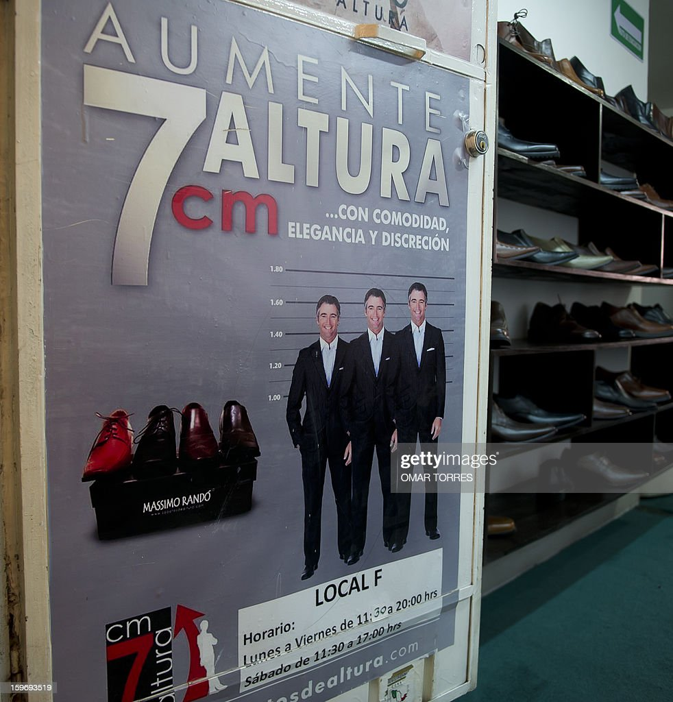View of the entrance of a men shoes store promoting shoes made with a hidden insole, to increase height, in Mexico City on January 16, 2013.
