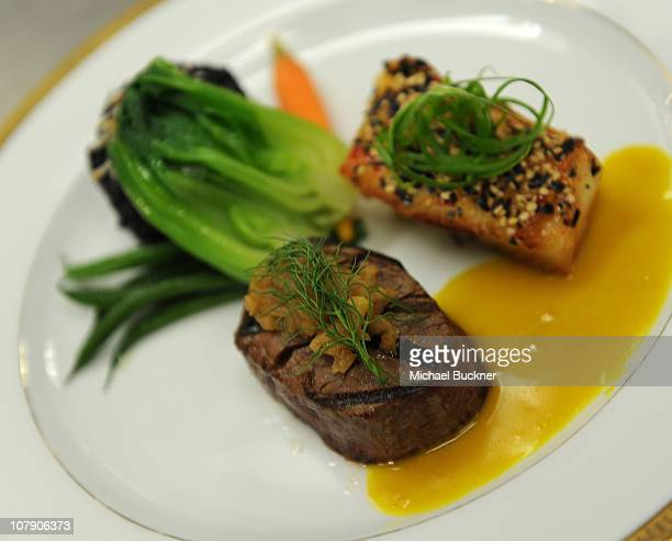 A view of the entree featuring grilled beef tenderloin with caramelized fennel marmalada and sauteed mild chili sesame crusted filet of sea bass is...