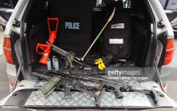 View of the equipment carried by a Metropolitan Police Armed Response Vehicle including a Heckler and Koch G36 rifle a Heckler and Koch MP5 rifle a...