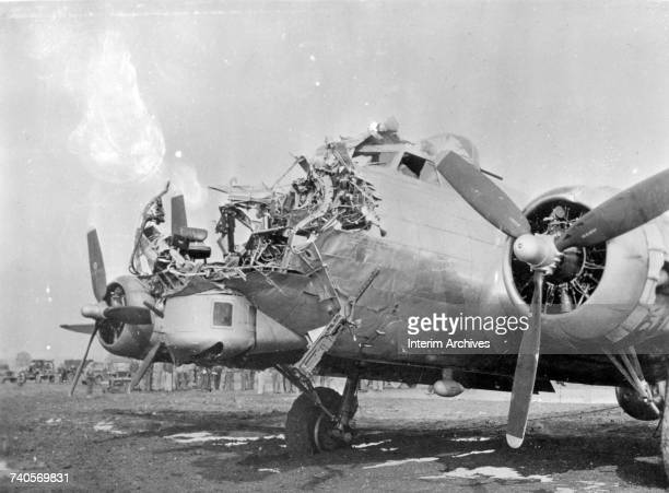 View of the extensive damage sustained on the nose of a B17 Flying Fortress after being shot up by antiaircraft artillery during bombing runs over...