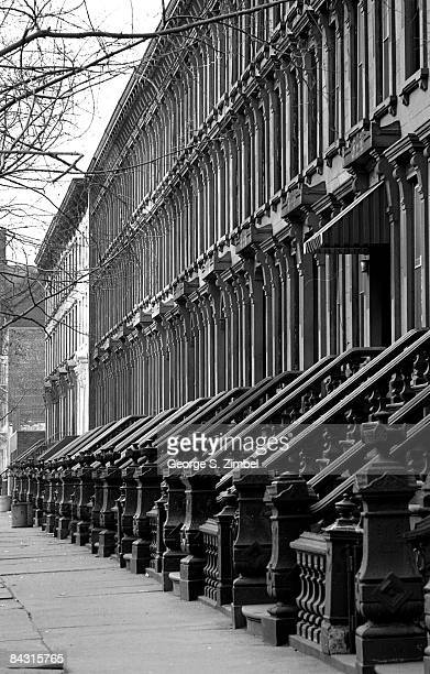 View of the exterior of a row of brownstones on an unidentified street in the Bedford Stuyvesant neighborhood of Brooklyn 1968 New York