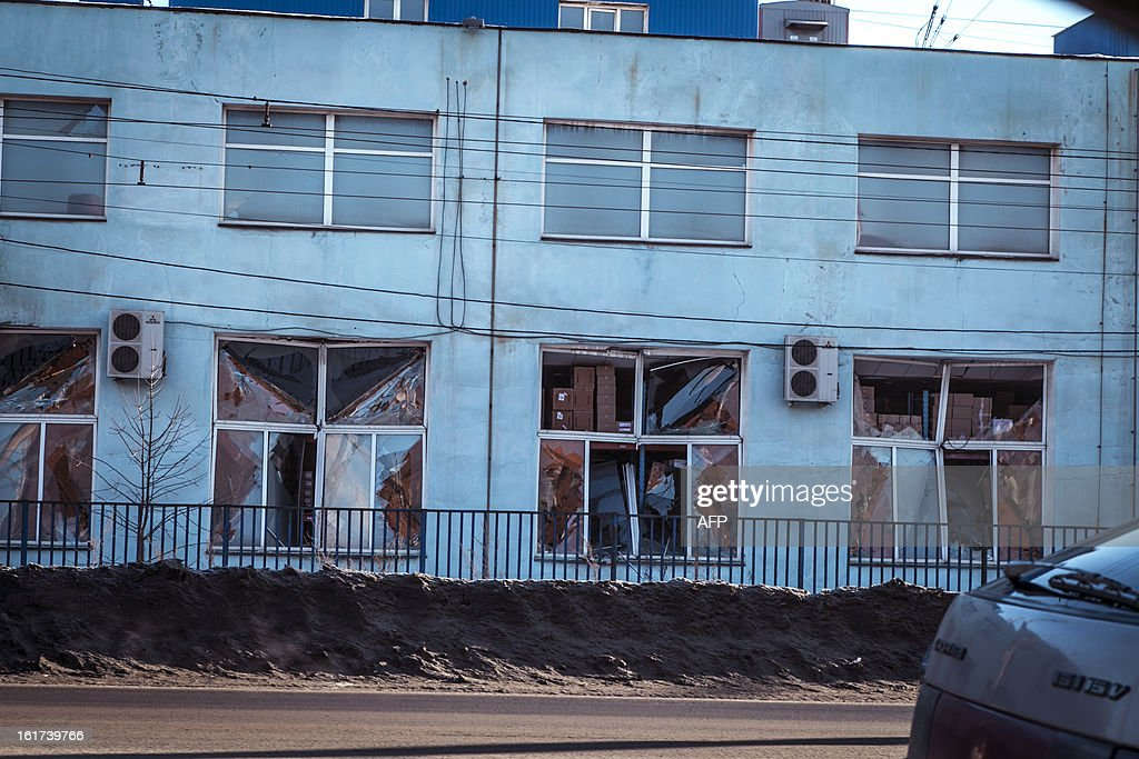 A view of the facade of a local paint and varnish plant which was damaged by a shockwave from a meteor in the Urals city of Chelyabinsk, on February 15, 2013. A meteor strike in central Russia that left today hundreds of people injured is the biggest known human toll from a space rock, a British expert said. AFP PHOTO / 74.RU/ OLEG KARGOPOLOV SOURCE--