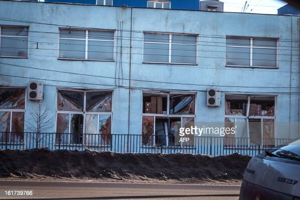 A view of the facade of a local paint and varnish plant which was damaged by a shockwave from a meteor in the Urals city of Chelyabinsk on February...