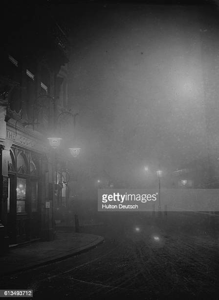 View of the faint street lights on Cannon Street from Bridge Row during fog