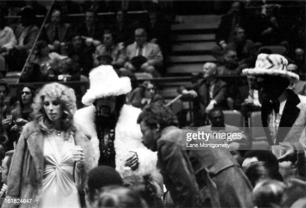 View of the fans attending the boxing match between American heavyweights boxer Muhammad Ali and Joe Frazier at Madison Square Garden New York New...
