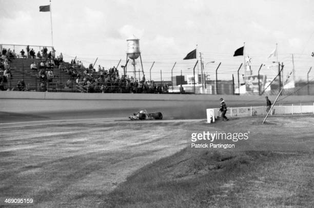 View of the fatal race car crash of American driver Art Pollard during a practice race for the Indianapolis 500 Indianapolis Indiana May 12 1973