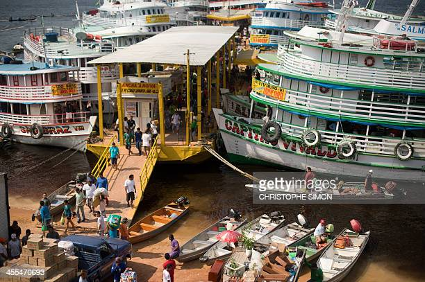 View of the ferry harbor of Manaus on Amazon river on 11 December 2013 Brazil Manaus will host FIFA Word Cup Brazil 2014 football matches AFP PHOTO /...
