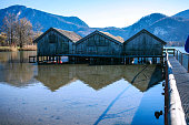 View of the fisherman house on the lake with boat In the Bavarian Alps